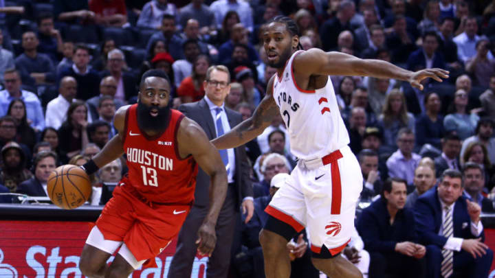James Harden #13 of the Houston Rockets dribbles the ball as Kawhi Leonard #2 of the Toronto Raptors (Photo by Vaughn Ridley/Getty Images)