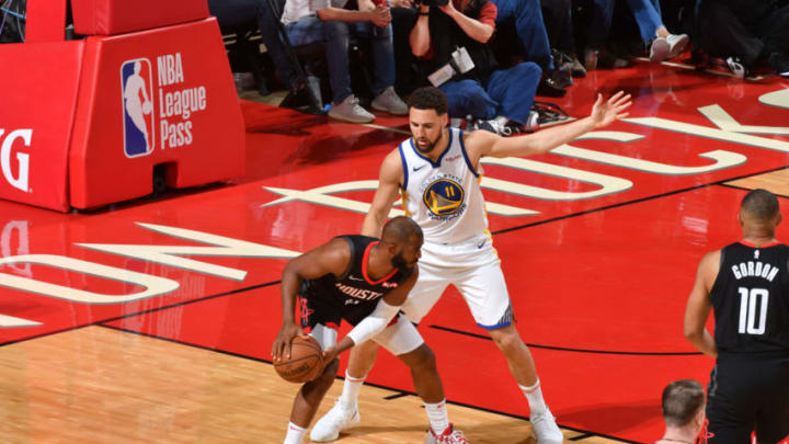 Chris Paul #3 of the Houston Rockets handles the ball against Klay Thompson #11 of the Golden State Warriors (Photo by Jesse D. Garrabrant/NBAE via Getty Images)