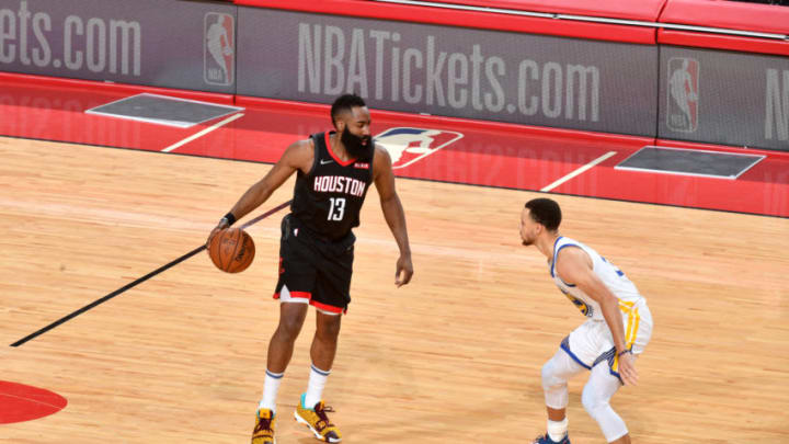 HOUSTON, TX - MARCH 13: James Harden #13 of the Houston Rockets handles the ball against Stephen Curry #30 of the Golden State Warriors on March 13, 2019 at the Toyota Center in Houston, Texas. NOTE TO USER: User expressly acknowledges and agrees that, by downloading and or using this photograph, User is consenting to the terms and conditions of the Getty Images License Agreement. Mandatory Copyright Notice: Copyright 2019 NBAE (Photo by Jesse D. Garrabrant/NBAE via Getty Images)