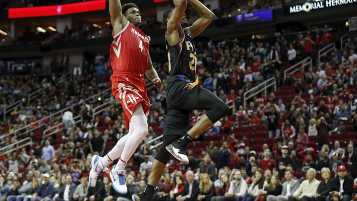 HOUSTON, TX – MARCH 15: Josh Jackson #20 of the Phoenix Suns goes up for a dunk defended by Danuel House Jr. #4 of the Houston Rockets in the second half at Toyota Center on March 15, 2019 in Houston, Texas. NOTE TO USER: User expressly acknowledges and agrees that, by downloading and or using this photograph, User is consenting to the terms and conditions of the Getty Images License Agreement. (Photo by Tim Warner/Getty Images)