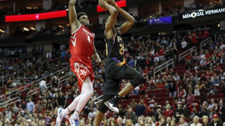 HOUSTON, TX - MARCH 15: Josh Jackson #20 of the Phoenix Suns goes up for a dunk defended by Danuel House Jr. #4 of the Houston Rockets in the second half at Toyota Center on March 15, 2019 in Houston, Texas. NOTE TO USER: User expressly acknowledges and agrees that, by downloading and or using this photograph, User is consenting to the terms and conditions of the Getty Images License Agreement. (Photo by Tim Warner/Getty Images)