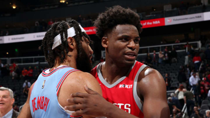 ATLANTA, GA - MARCH 19: DeAndre' Bembry #95 of the Atlanta Hawks hugs Danuel House Jr. #4 of the Houston Rockets after the game on March 19, 2019 at State Farm Arena in Atlanta, Georgia. NOTE TO USER: User expressly acknowledges and agrees that, by downloading and/or using this Photograph, user is consenting to the terms and conditions of the Getty Images License Agreement. Mandatory Copyright Notice: Copyright 2019 NBAE (Photo by Jasear Thompson/NBAE via Getty Images)