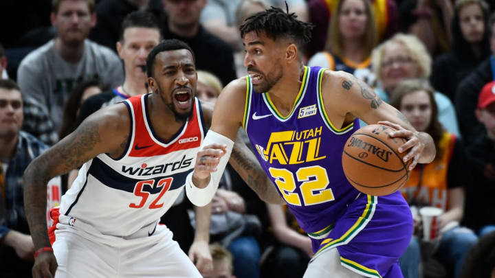 Thabo Sefolosha #22 of the Utah Jazz attempts to drive past Jordan McRae #52 of the Washington Wizards (Photo by Alex Goodlett/Getty Images)