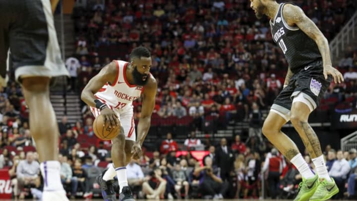 HOUSTON, TX - MARCH 30: James Harden #13 of the Houston Rockets dribbles the ball defended by Willie Cauley-Stein #00 of the Sacramento Kings in the first half at Toyota Center on March 30, 2019 in Houston, Texas. NOTE TO USER: User expressly acknowledges and agrees that, by downloading and or using this photograph, User is consenting to the terms and conditions of the Getty Images License Agreement. (Photo by Tim Warner/Getty Images)