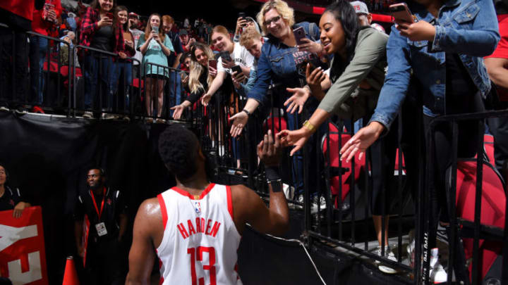 James Harden #13 of the Houston Rockets hi-fives fans after the game against the Sacramento Kings (Photo by Bill Baptist/NBAE via Getty Images)