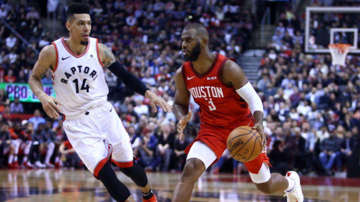 TORONTO, ON - MARCH 5: Chris Paul #3 of the Houston Rockets dribbles the ball as Danny Green #14 of the Toronto Raptors defends during the second half of an NBA game at Scotiabank Arena on March 5, 2019 in Toronto, Canada. NOTE TO USER: User expressly acknowledges and agrees that, by downloading and or using this photograph, User is consenting to the terms and conditions of the Getty Images License Agreement. (Photo by Vaughn Ridley/Getty Images)