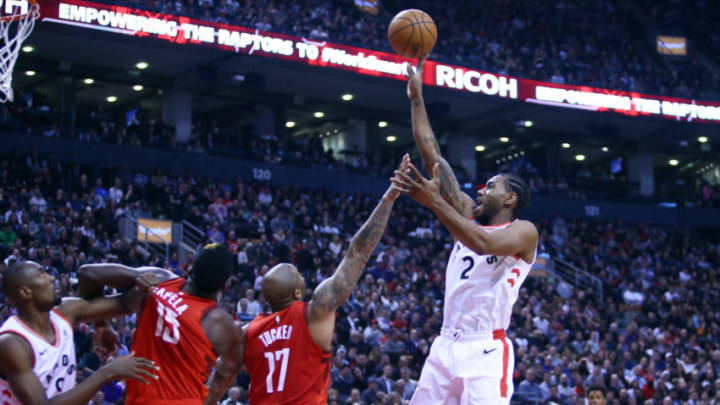 TORONTO, ON - MARCH 5: Kawhi Leonard #2 of the Toronto Raptors shoots the ball during the first half of an NBA game against the Houston Rockets at Scotiabank Arena on March 5, 2019 in Toronto, Canada. NOTE TO USER: User expressly acknowledges and agrees that, by downloading and or using this photograph, User is consenting to the terms and conditions of the Getty Images License Agreement. (Photo by Vaughn Ridley/Getty Images)