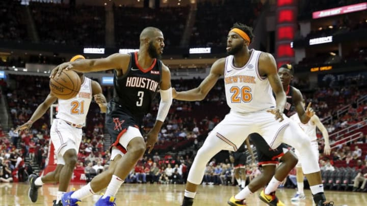 HOUSTON, TX - APRIL 05: Chris Paul #3 of the Houston Rockets drives to the basket defended by Mitchell Robinson #26 of the New York Knicks in the first half at Toyota Center on April 5, 2019 in Houston, Texas. NOTE TO USER: User expressly acknowledges and agrees that, by downloading and or using this photograph, User is consenting to the terms and conditions of the Getty Images License Agreement. (Photo by Tim Warner/Getty Images)