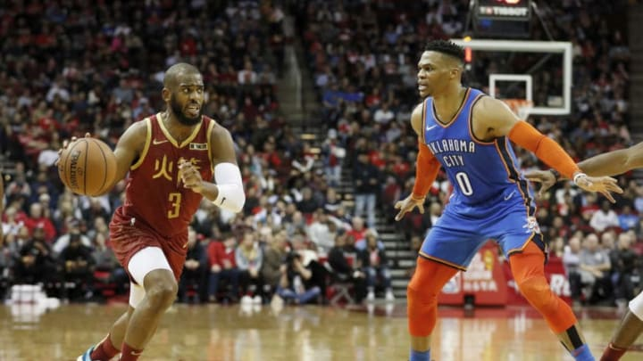 HOUSTON, TX - FEBRUARY 09: Chris Paul #3 of the Houston Rockets drives to the basket defended by Russell Westbrook #0 of the Oklahoma City Thunder in the first half at Toyota Center on February 9, 2019 in Houston, Texas. NOTE TO USER: User expressly acknowledges and agrees that, by downloading and or using this photograph, User is consenting to the terms and conditions of the Getty Images License Agreement. (Photo by Tim Warner/Getty Images)