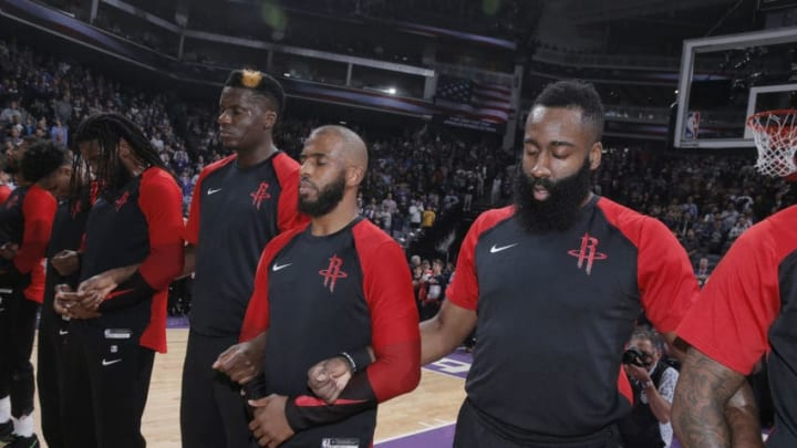 SACRAMENTO, CA - APRIL 2: Clint Capela #15, Chris Paul #3 and James Harden #13 of the Houston Rockets link arms for the national anthem of the game against the Sacramento Kings on April 2, 2019 at Golden 1 Center in Sacramento, California. NOTE TO USER: User expressly acknowledges and agrees that, by downloading and or using this photograph, User is consenting to the terms and conditions of the Getty Images Agreement. Mandatory Copyright Notice: Copyright 2019 NBAE (Photo by Rocky Widner/NBAE via Getty Images)
