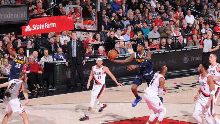 PORTLAND, OR - APRIL 7: Torrey Craig #3 of the Denver Nuggets shoots the ball against the Portland Trail Blazers on April 7, 2019 at the Moda Center Arena in Portland, Oregon. NOTE TO USER: User expressly acknowledges and agrees that, by downloading and or using this photograph, user is consenting to the terms and conditions of the Getty Images License Agreement. Mandatory Copyright Notice: Copyright 2019 NBAE (Photo by Sam Forencich/NBAE via Getty Images)