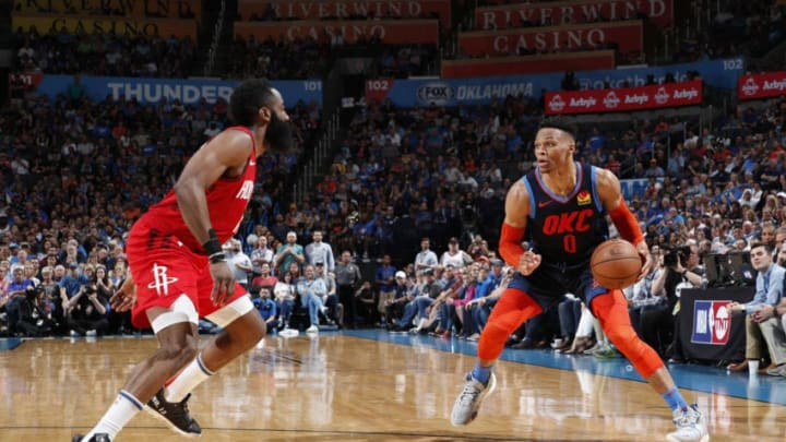 Russell Westbrook #0 of the Oklahoma City Thunder handles the ball during the game against James Harden #13 of the Houston Rockets (Photo by Jeff Haynes/NBAE via Getty Images)
