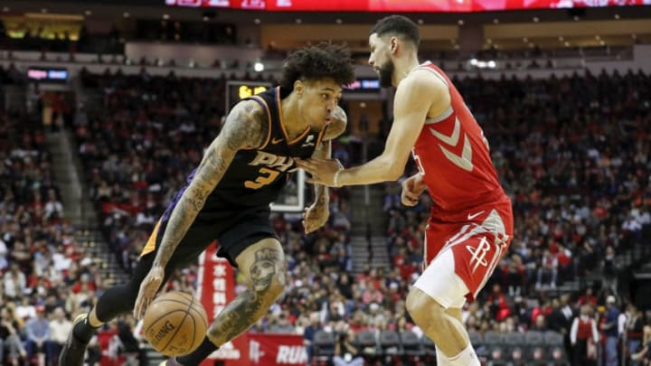Kelly Oubre Jr. #3 of the Phoenix Suns drives to the basket defended by Austin Rivers #25 of the Houston Rockets (Photo by Tim Warner/Getty Images)