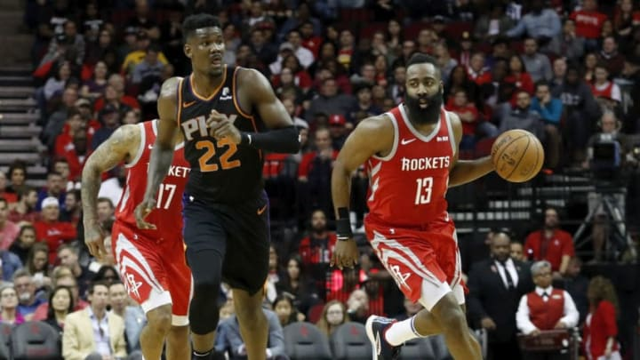 HOUSTON, TX - MARCH 15: James Harden #13 of the Houston Rockets dribbles the ball on a fast break defended by Deandre Ayton #22 of the Phoenix Suns in the first half at Toyota Center on March 15, 2019 in Houston, Texas. NOTE TO USER: User expressly acknowledges and agrees that, by downloading and or using this photograph, User is consenting to the terms and conditions of the Getty Images License Agreement. (Photo by Tim Warner/Getty Images)