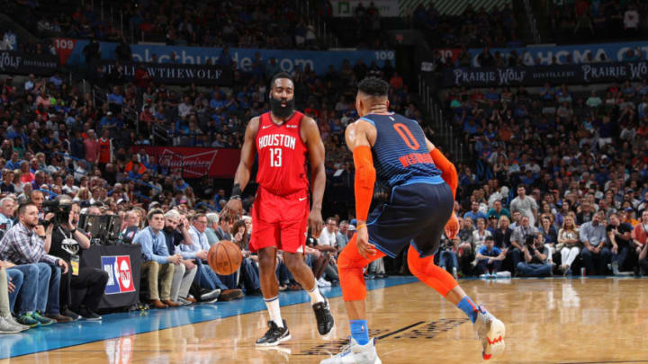 James Harden #13 of the Houston Rockets handles the ball against Russell Westbrook #0 of the Oklahoma City Thunder (Photo by Zach Beeker/NBAE via Getty Images)