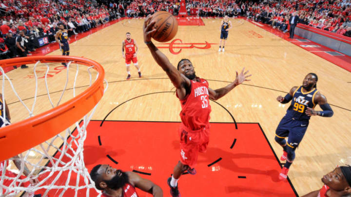 HOUSTON, TX - APRIL 17: Kenneth Faried #35 of the Houston Rockets rebounds the ball against the Utah Jazz during Game Two of Round One of the 2019 NBA Playoffs on April 17, 2019 at the Toyota Center in Houston, Texas. NOTE TO USER: User expressly acknowledges and agrees that, by downloading and/or using this photograph, user is consenting to the terms and conditions of the Getty Images License Agreement. Mandatory Copyright Notice: Copyright 2019 NBAE (Photo by Bill Baptist/NBAE via Getty Images)