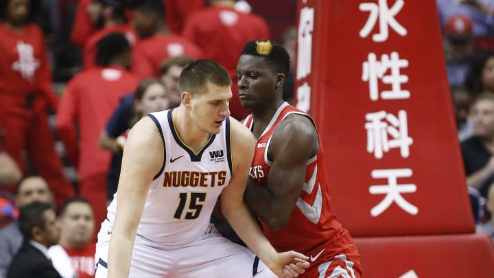 HOUSTON, TEXAS – MARCH 28: Nikola Jokic #15 of the Denver Nuggets backs in on Clint Capela #15 of the Houston Rockets during the first quarter at Toyota Center on March 28, 2019 in Houston, Texas. NOTE TO USER: User expressly acknowledges and agrees that, by downloading and or using this photograph, User is consenting to the terms and conditions of the Getty Images License Agreement. (Photo by Bob Levey/Getty Images)