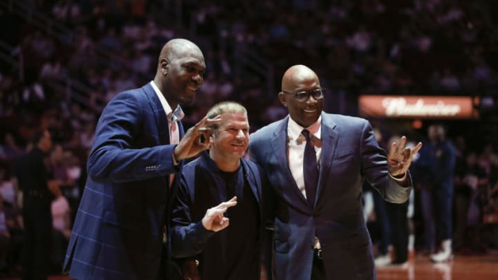 Hakeem Olajuwon, Houston Rockets owner Tilman Fertitta and Clyde Drexler (Photo by Bob Levey/Getty Images)
