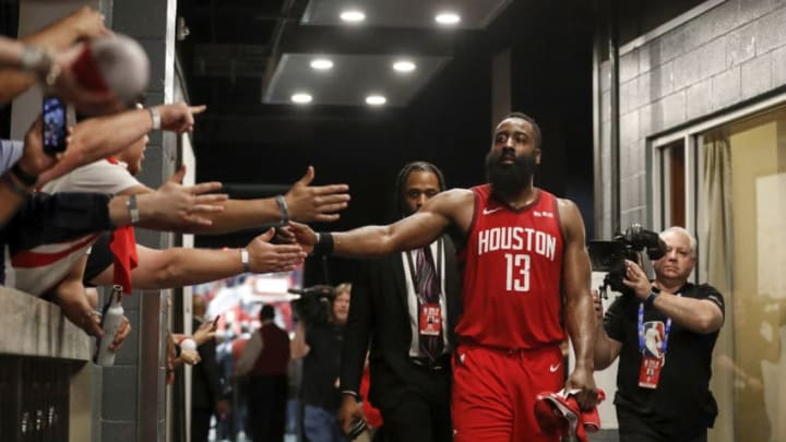 HOUSTON, TX - APRIL 24: James Harden #13 of the Houston Rockets greets fans on the way to the locker room after Game Five of the first round of the 2019 NBA Western Conference Playoffs between the Houston Rockets and the Utah Jazz at Toyota Center on April 24, 2019 in Houston, Texas. NOTE TO USER: User expressly acknowledges and agrees that, by downloading and or using this photograph, User is consenting to the terms and conditions of the Getty Images License Agreement. (Photo by Tim Warner/Getty Images)
