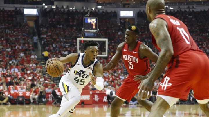 HOUSTON, TX – APRIL 24: Donovan Mitchell #45 of the Utah Jazz drives to the basket defended by Clint Capela #15 of the Houston Rockets in the first half during Game Five of the first round of the 2019 NBA Western Conference Playoffs between the Houston Rockets and the Utah Jazz at Toyota Center on April 24, 2019 in Houston, Texas. NOTE TO USER: User expressly acknowledges and agrees that, by downloading and or using this photograph, User is consenting to the terms and conditions of the Getty Images License Agreement. (Photo by Tim Warner/Getty Images)