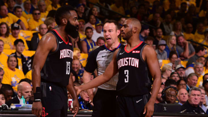 OAKLAND, CA - APRIL 28: James Harden #13, and Chris Paul #3 of the Houston Rockets talks during Game One of the Western Conference Semifinals of the 2019 NBA Playoffs against the Golden State Warriors on April 28, 2019 at ORACLE Arena in Oakland, California. NOTE TO USER: User expressly acknowledges and agrees that, by downloading and or using this photograph, User is consenting to the terms and conditions of the Getty Images License Agreement. Mandatory Copyright Notice: Copyright 2019 NBAE (Photo by Noah Graham/NBAE via Getty Images)