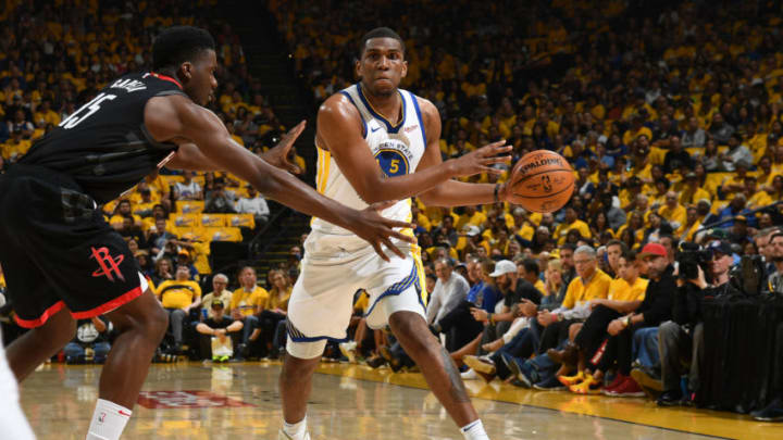 Kevon Looney #5 of the Golden State Warriors handles the ball against the Houston Rockets (Photo by Noah Graham/NBAE via Getty Images)