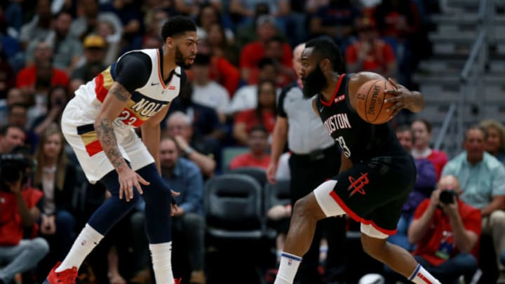 NEW ORLEANS, LOUISIANA - MARCH 24: James Harden #13 of the Houston Rockets is defended by Anthony Davis #23 of the New Orleans Pelicans during the first half at the Smoothie King Center on March 24, 2019 in New Orleans, Louisiana. NOTE TO USER: User expressly acknowledges and agrees that, by downloading and or using this photograph, User is consenting to the terms and conditions of the Getty Images License Agreement. (Photo by Sean Gardner/Getty Images)