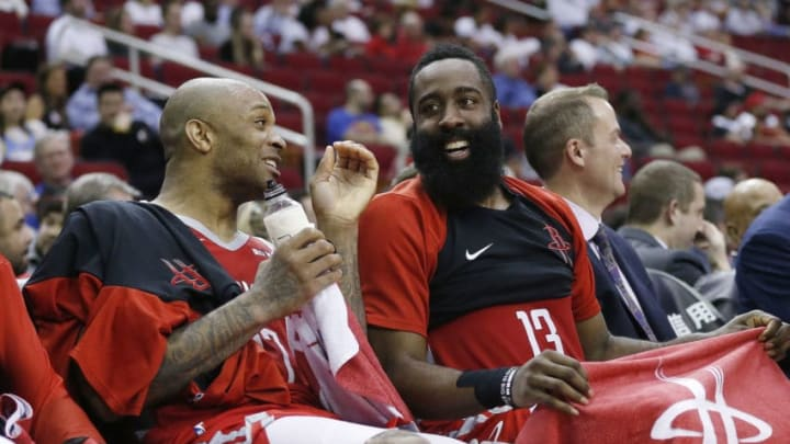 HOUSTON, TEXAS - MARCH 28: PJ Tucker #17 of the Houston Rockets (L) and James Harden #13 share a laugh on the bench during a game against the Denver Nuggets at Toyota Center on March 28, 2019 in Houston, Texas. NOTE TO USER: User expressly acknowledges and agrees that, by downloading and or using this photograph, User is consenting to the terms and conditions of the Getty Images License Agreement. (Photo by Bob Levey/Getty Images)