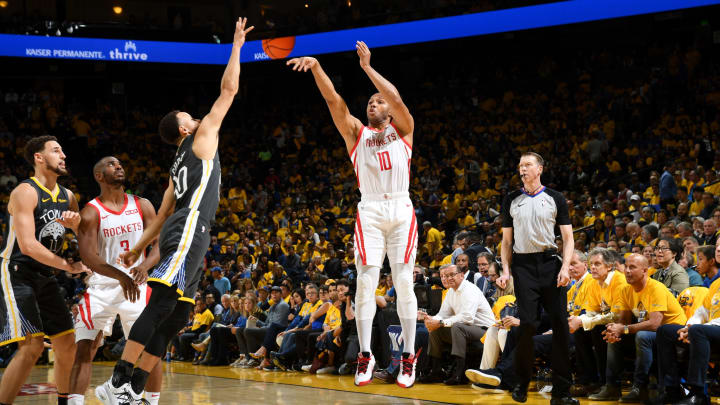 Eric Gordon #10 of the Houston Rockets shoots the ball against the Golden State Warriors (Photo by Noah Graham/NBAE via Getty Images)