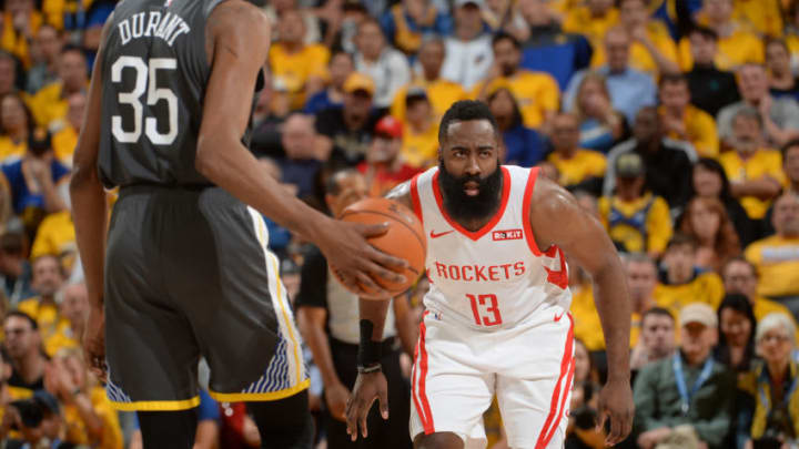 OAKLAND, CA - APRIL 30: James Harden #13 of the Houston Rockets looks on during Game Two of the Western Conference Semifinals of the 2019 NBA Playoffs against the Golden State Warriors on April 30, 2019 at ORACLE Arena in Oakland, California. NOTE TO USER: User expressly acknowledges and agrees that, by downloading and or using this photograph, user is consenting to the terms and conditions of Getty Images License Agreement. Mandatory Copyright Notice: Copyright 2019 NBAE (Photo by Noah Graham/NBAE via Getty Images)