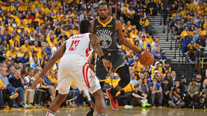 OAKLAND, CA - APRIL 30: Kevin Durant #35 of the Golden State Warriors looks to make a play against the Houston Rockets during Game Two of the Western Conference Semi-Finals of the 2019 NBA Playoffs on April 30, 2019 at ORACLE Arena in Oakland, California. NOTE TO USER: User expressly acknowledges and agrees that, by downloading and or using this photograph, user is consenting to the terms and conditions of Getty Images License Agreement. Mandatory Copyright Notice: Copyright 2019 NBAE (Photo by Andrew D. Bernstein/NBAE via Getty Images)