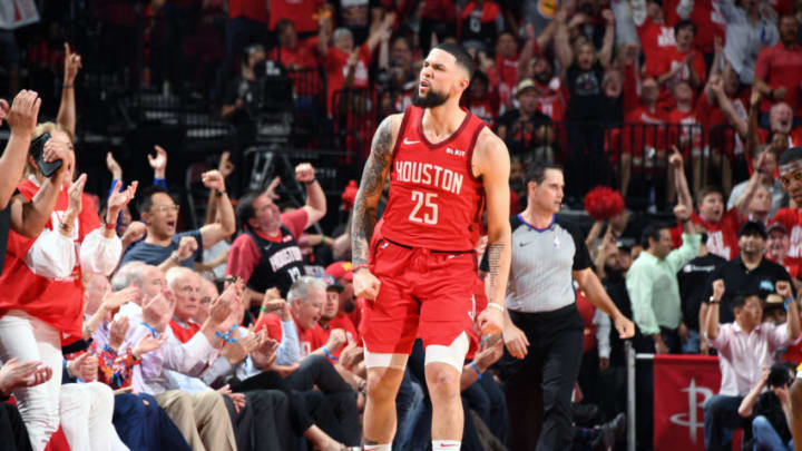 Austin Rivers #25 of the Houston Rockets reacts to a play against the Golden State Warriors (Photo by Andrew D. Bernstein/NBAE via Getty Images)