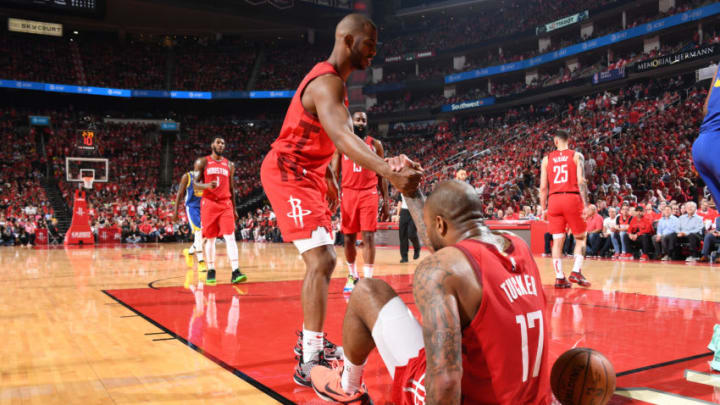 Chris Paul #3 helps up PJ Tucker #17 of the Houston Rockets (Photo by Andrew D. Bernstein/NBAE via Getty Images)