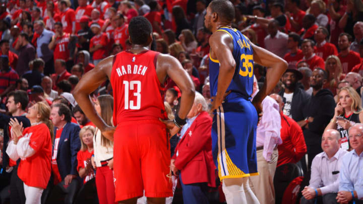 HOUSTON, TX - MAY 6: James Harden #13 of the Houston Rockets and Kevin Durant #35 of the Golden State Warriors look on during Game Four of the Western Conference Semifinals of the 2019 NBA Playoffs on May 6, 2019 at the Toyota Center in Houston, Texas. NOTE TO USER: User expressly acknowledges and agrees that, by downloading and/or using this photograph, user is consenting to the terms and conditions of the Getty Images License Agreement. Mandatory Copyright Notice: Copyright 2019 NBAE (Photo by Bill Baptist/NBAE via Getty Images)