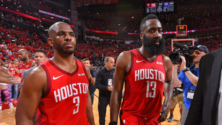 HOUSTON, TX – MAY 4 : Chris Paul #3 and James Harden #13 of the Houston Rockets look on after Game Three of the Western Conference SemiFinals of the 2019 NBA Playoffs against the Golden State Warriors on May 4, 2019 at the Toyota Center in Houston, Texas. NOTE TO USER: User expressly acknowledges and agrees that, by downloading and or using this photograph, User is consenting to the terms and conditions of the Getty Images License Agreement. Mandatory Copyright Notice: Copyright 2019 NBAE (Photo by Bill Baptist/NBAE via Getty Images)