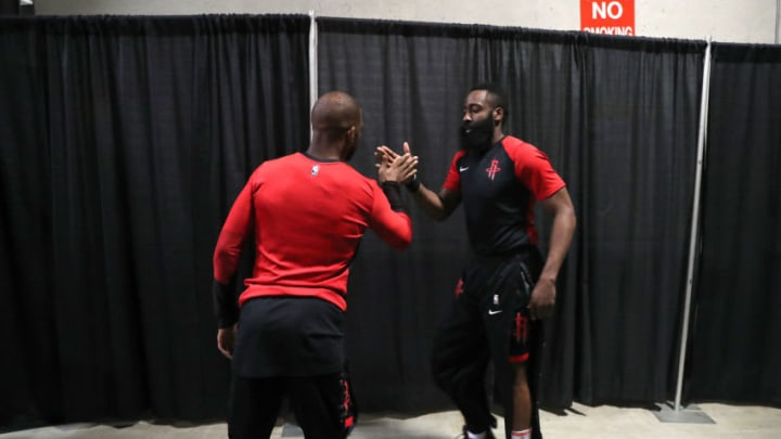 OAKLAND, CA - MAY 8:Chris Paul #3 and James Harden #13 of the Houston Rockets high five before Game Five of the Western Conference Semifinals against the Golden State Warriors during the 2019 NBA Playoffs on May 8, 2019 at ORACLE Arena in Oakland, California. NOTE TO USER: User expressly acknowledges and agrees that, by downloading and/or using this photograph, user is consenting to the terms and conditions of Getty Images License Agreement. Mandatory Copyright Notice: Copyright 2019 NBAE (Photo by Joe Murphy/NBAE via Getty Images)