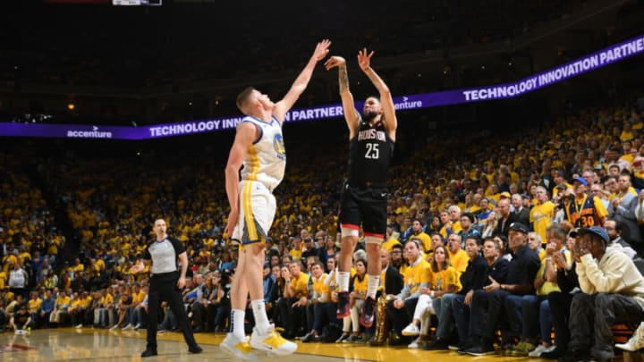 OAKLAND, CA - MAY 8: Austin Rivers #25 of the Houston Rockets shoots a three point basket against the Golden State Warriors during Game Five of the Western Conference Semifinals of the 2019 NBA Playoffs on May 8, 2019 at ORACLE Arena in Oakland, California. NOTE TO USER: User expressly acknowledges and agrees that, by downloading and/or using this photograph, user is consenting to the terms and conditions of Getty Images License Agreement. Mandatory Copyright Notice: Copyright 2019 NBAE (Photo by Noah Graham/NBAE via Getty Images)