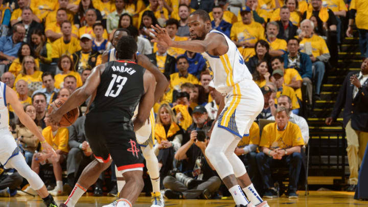 OAKLAND, CA - MAY 8: Kevin Durant #35 of the Golden State Warriors defends James Harden #13 of the Houston Rockets during Game Five of the Western Conference Semifinals of the 2019 NBA Playoffs on May 8, 2019 at ORACLE Arena in Oakland, California. NOTE TO USER: User expressly acknowledges and agrees that, by downloading and/or using this photograph, user is consenting to the terms and conditions of Getty Images License Agreement. Mandatory Copyright Notice: Copyright 2019 NBAE (Photo by Noah Graham/NBAE via Getty Images)