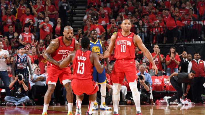 PJ Tucker #17 and Eric Gordon #10 help up James Harden #13 of the Houston Rockets (Photo by Andrew D. Bernstein/NBAE via Getty Images)