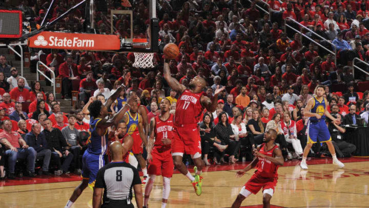 PJ Tucker #17 of the Houston Rockets grabs the rebound against the Golden State Warriors (Photo by Bill Baptist/NBAE via Getty Images)