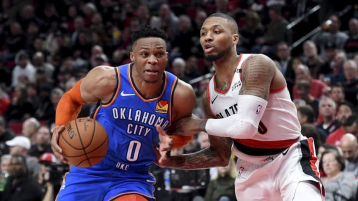 Russell Westbrook #0 of the Oklahoma City Thunder drives to the basket on Damian Lillard #0 of the Portland Trail Blazers(Photo by Steve Dykes/Getty Images)