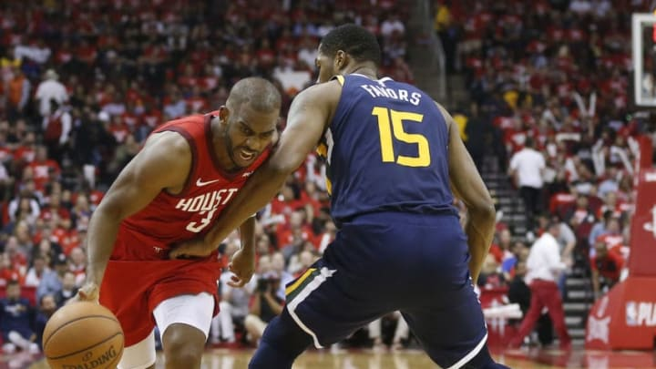 HOUSTON, TEXAS - APRIL 17: Chris Paul #3 of the Houston Rockets attempts to drive around Derrick Favors #15 of the Utah Jazz during Game Two of the first round of the 2019 NBA Western Conference Playoffs between the Houston Rockets and the Utah Jazz at Toyota Center on April 17, 2019 in Houston, Texas. NOTE TO USER: User expressly acknowledges and agrees that, by downloading and or using this photograph, User is consenting to the terms and conditions of the Getty Images License Agreement. (Photo by Bob Levey/Getty Images)