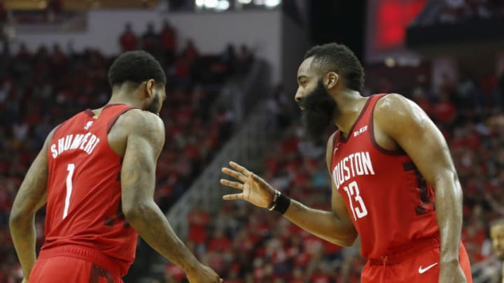 James Harden #13 of the Houston Rockets talks with Iman Shumpert #1 (Photo by Tim Warner/Getty Images)