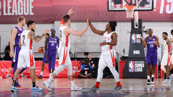 LAS VEGAS, NV – JULY 9: Zach Thomas #64 and Chris Clemons #59 of the Houston Rockets high five during the game against the Sacramento Kings on July 9, 2019 at the Cox Pavilion in Las Vegas, Nevada. NOTE TO USER: User expressly acknowledges and agrees that, by downloading and/or using this photograph, user is consenting to the terms and conditions of the Getty Images License Agreement. Mandatory Copyright Notice: Copyright 2019 NBAE (Photo by Bart Young/NBAE via Getty Images)