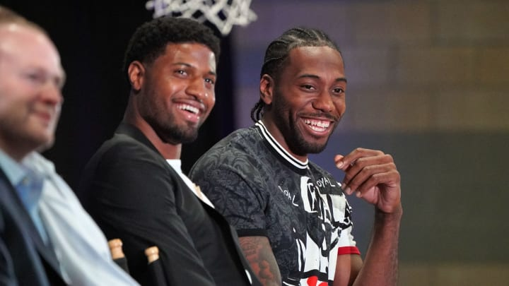 LOS ANGELES, CA – JULY 24: New Clippers players Paul George, left, and Kawhi Leonard laugh during a press conference at the Green Meadows Recreation Center in Los Angeles on Wednesday, July 24, 2019. George and Leonard were introduced to the media and fans as the newest members of the Clippers. (Photo by Scott Varley/MediaNews Group/Daily Breeze via Getty Images)