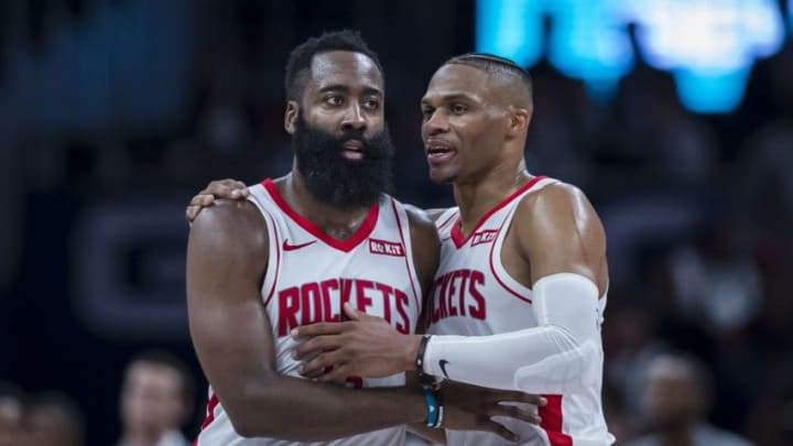 James Harden #13 of the Houston Rockets speaks with Russell Westbrook #0 (Photo by Scott Taetsch/Getty Images)