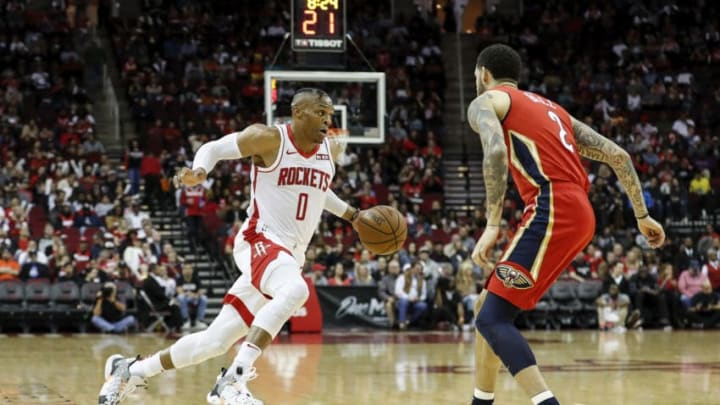 Russell Westbrook #0 of the Houston Rockets drives to the basket defended by Lonzo Ball #2 of the New Orleans Pelicans (Photo by Tim Warner/Getty Images)