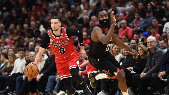 Zach LaVine #8 of the Chicago Bulls drives around James Harden #13 of the Houston Rockets (Photo by Stacy Revere/Getty Images)