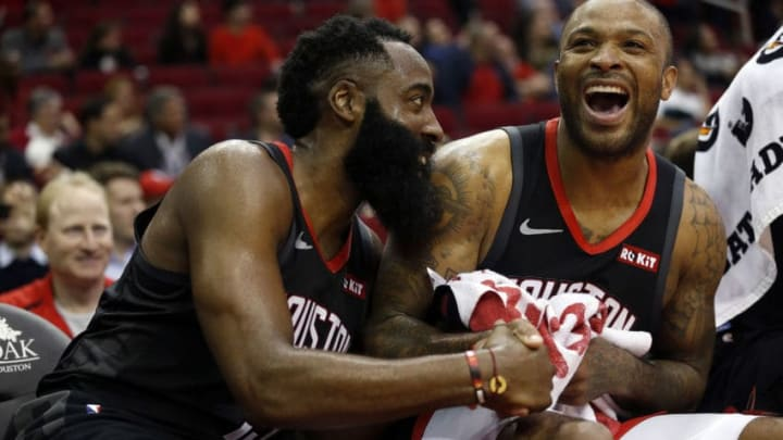 James Harden #13 of the Houston Rockets and PJ Tucker #17 (Photo by Bob Levey/Getty Images)