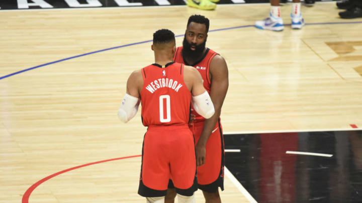 LOS ANGELES, CA - DECEMBER 19: Russell Westbrook #0 and James Harden #13 of the Houston Rockets talk during a game against the LA Clippers on December 19, 2019 at STAPLES Center in Los Angeles, California. NOTE TO USER: User expressly acknowledges and agrees that, by downloading and/or using this Photograph, user is consenting to the terms and conditions of the Getty Images License Agreement. Mandatory Copyright Notice: Copyright 2019 NBAE (Photo by Adam Pantozzi/NBAE via Getty Images)